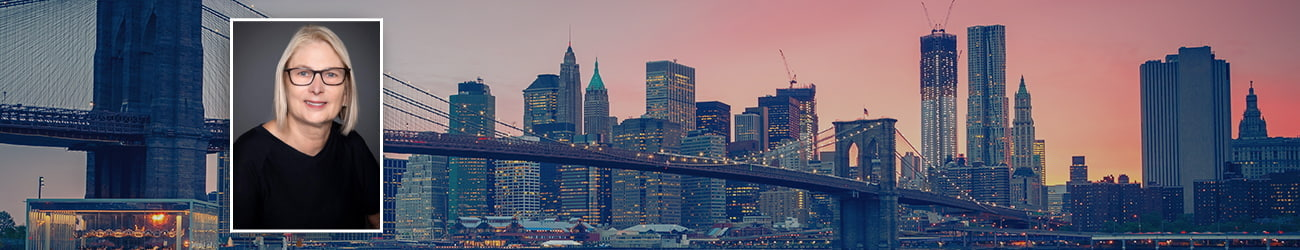 Brooklyn bridge at dusk, New York City and a picture frame of Attorney Valerie S. Wolfman, Esq.
